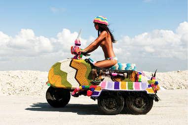 Toppless girl and bike