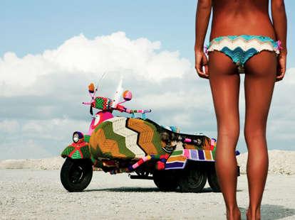 Topless girl and bike