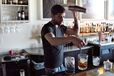 Bartender at Rye on Market mixing two drinks at once.