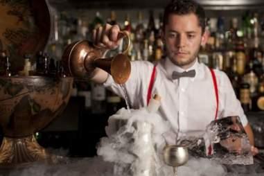 Bartender making cocktails at The Worship Street Whistling Shop