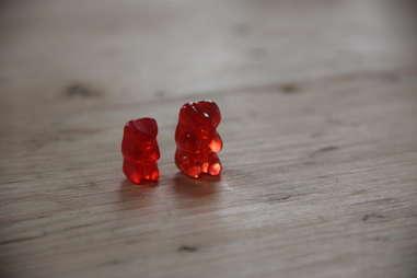A regular gummy bear next to a vodka gummy bear