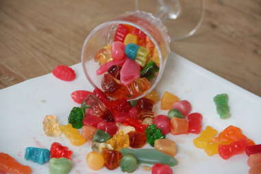 A cup exploding with vodka gummies