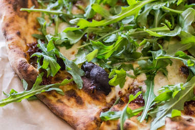 Bacon marmalde pizza with arugula from Pieous