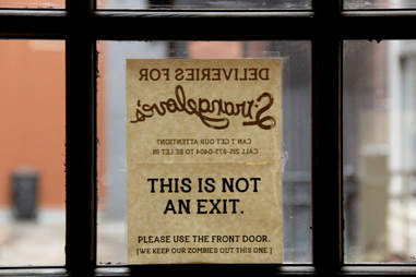 A zombie sign on the window of Strangelove's