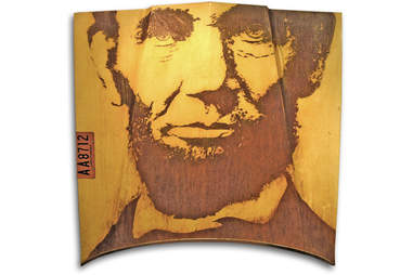 Abraham Lincoln's face, rusted onto a classic car hood