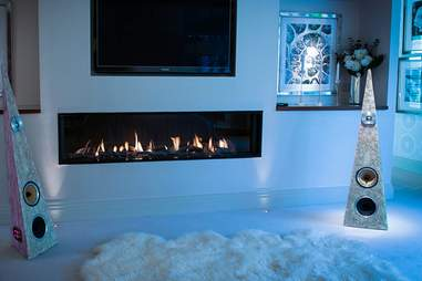 Speakers from Rinz Sound near a fireplace