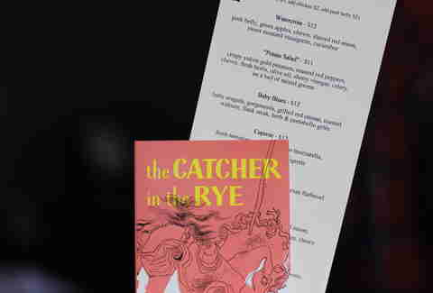 Catcher in the Rye holds a menu at Renegade Publik House