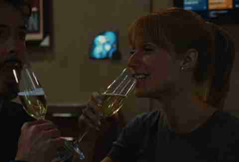 Tony Stark and Pepper Potts drink champagne in Iron Man 2.