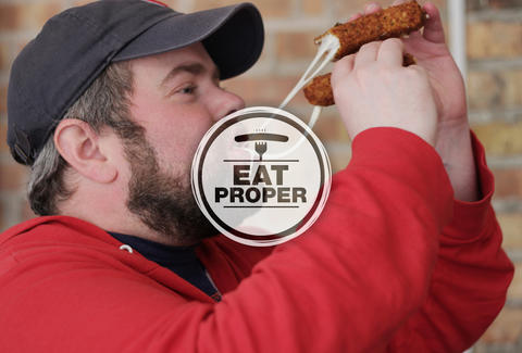 Thrillist Senior editor Matt Lynch eats mozzarella sticks from Roots Handmade Pizza in Chicago