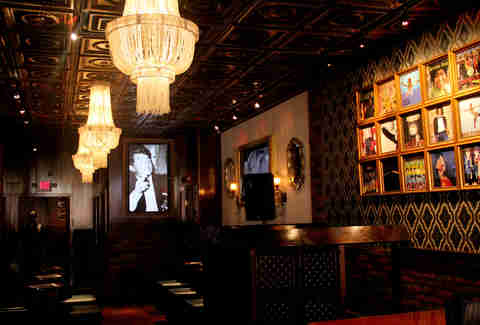 The chandelier-lit backroom features tufted banquettes and a DJ booth