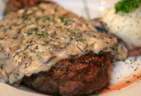 Mushroom sauce covered 12oz rib eye at Juana M Brickell