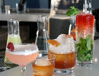 Numerous cocktails on a bar