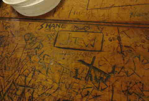 Counter carvings at Louis Lunch