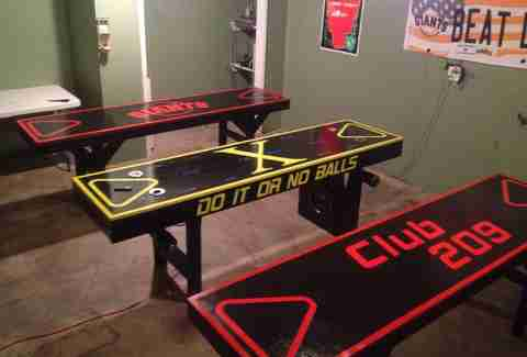 Beer pong table with automatic ball washers