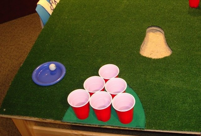 Beer pong tables with automatic ball washers and friggin\' moats