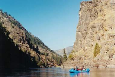 raft on river between two cliffs