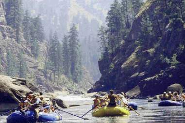 a couple full rafts paddling down river