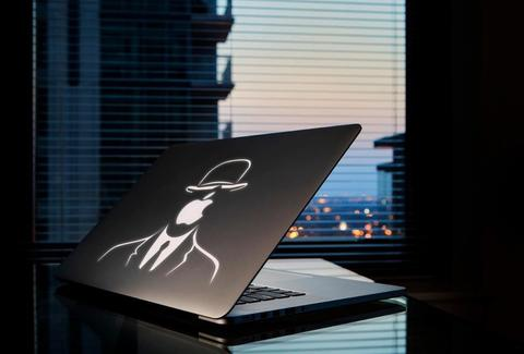 Macbook with Magritte's Son of Man