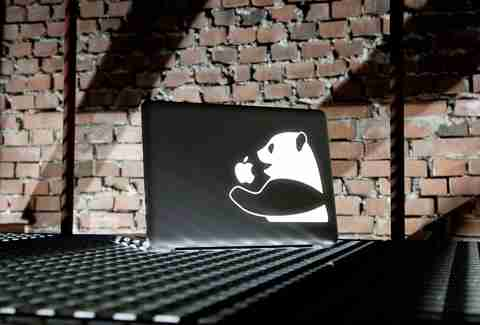Macbook with a panda eating an apple