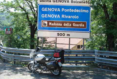 Road sign for Genova