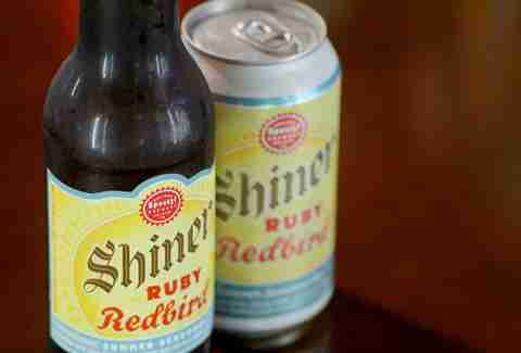 A bottle and can of Shiner's Ruby Redbird