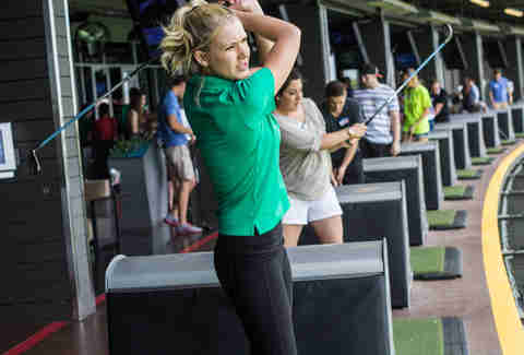 TopGolf Jill swings a club