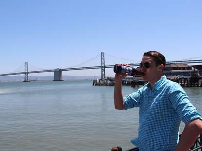 Thrillist editor Joe Starkey enjoying a beer in the sun