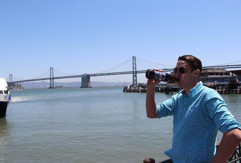 Thrillist editor Joe Starkey enjoying a beer in the sun