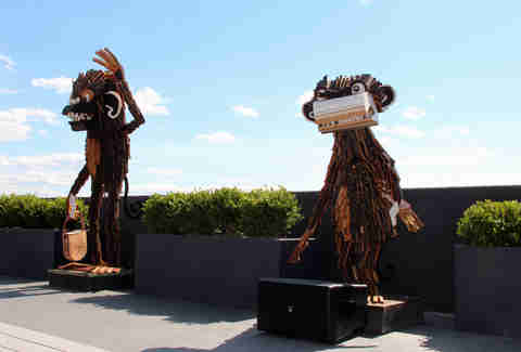 Wooden statues on the Revere Hotel's roofdeck