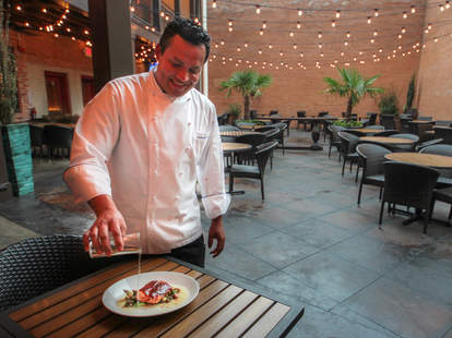 Chef Nico Sanchez pours Tequila at Meso Maya, Dallas TX