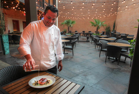 Chef Nico Sanchez pours Tequila at Meso Maya, Dallas TX