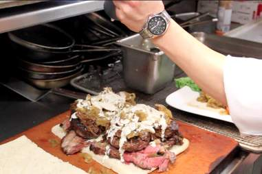 The chef squeezes balsamic syrup atop Bally's Preview Bar's Carving Board Burger