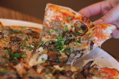Italian Sausage and Wild Mushroom pizza at Live Basil
