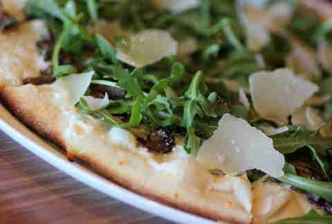 cheese on a pizza at Live Basil