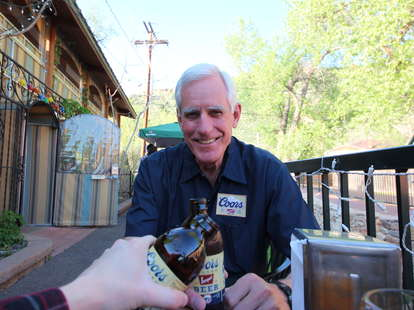 Pete Coors posing with a beer