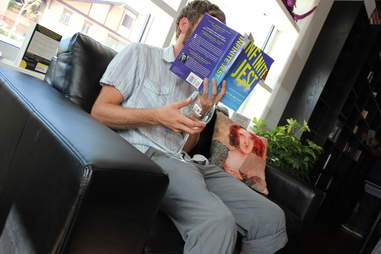 guy reading a book at BookBar