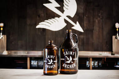 Growlers ready to be filled at Saint Archer Brewery in San Diego.