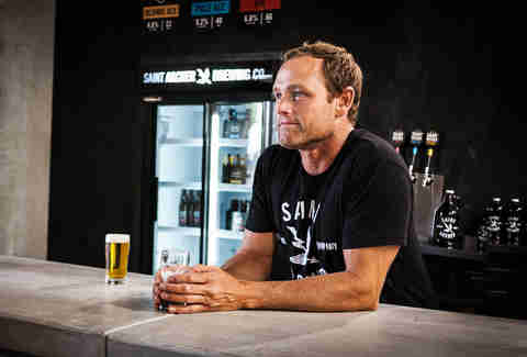 Pro surfer Taylor Knox enjoying a beer at Saint Archer Brewery.