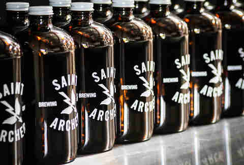 Growlers waiting to be filled at Saint Archer Brewery in San Diego.