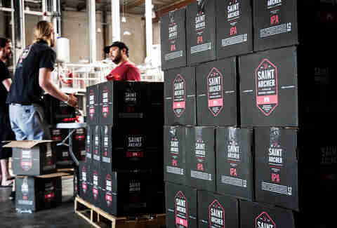 Capping bottles of Saint Archer IPA at Saint Archer Brewery in San Diego.