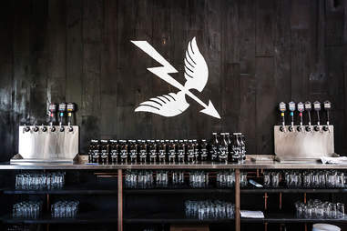 Growlers on display at Saint Archer Brewery in San Diego.