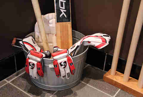Bucket of cricket equipment at Hit Wicket