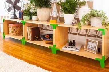 Long Soapbox shelf with green hardware