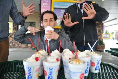 guy eats a vanilla shake at Sonic