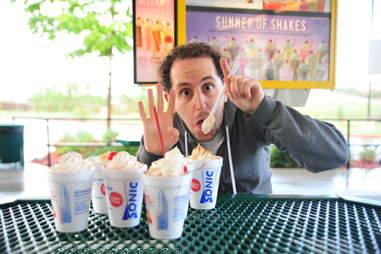 guy eats a coconut cream pie milkshake at Sonic