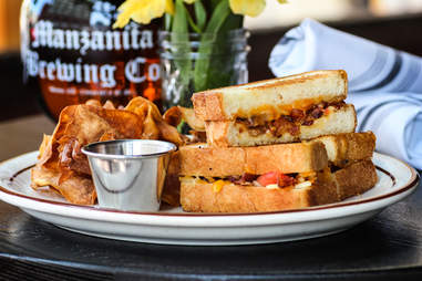 Grilled Cheese Sandwich with bacon, tomato and fried onion at Magnolia Tap and Kitchen in downtown San Diego.