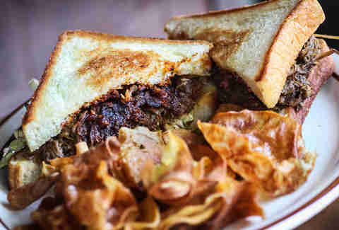 Braised Short Rib Sandwich with house bbq sauce at Magnolia Tap and Kitchen in downtown San Diego.