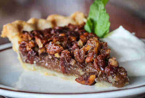 Homemade Pecan Pie with bourbon whipped cream at Magnolia Tap and Kitchen in downtown San Diego.