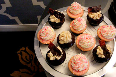 Chocolate covered bacon topped Yards beer cupcakes and pink champagne cupcakes from Sweet Box Bakery
