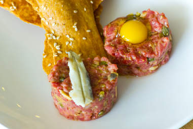 Saltyard - classic German steak tartare w/ quail egg and white anchovy